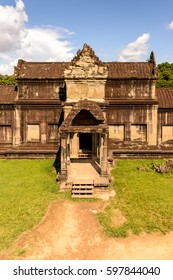 Wall of the Angkor Wat (Temple City), a Buddhist temple complex in Cambodia and the largest religious monument in the world. View from the garden