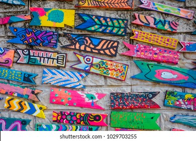 Wall art decorated with painted wooden fish in Gamcheon Culture Village, Busan South Korea.