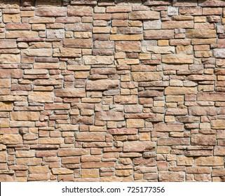 Wall beige stone background.
