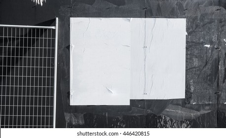 Wall with blank poster and torn posters - empty banner ready for your artwork