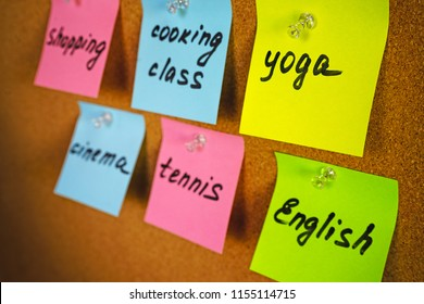Wall board with colorful stickers reminders activities and hobbies yoga English cooking class tennis shopping cinema