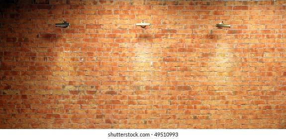 Wall of brick illuminated by three lighting equipments