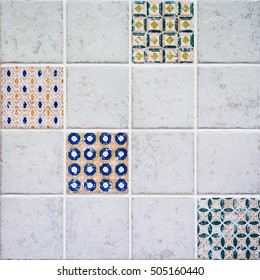 Wall of bright ceramic tiles in vintage style. Geometric pattern details. Kitchen decoration. Dimension of square is 10 x 10 cm.
