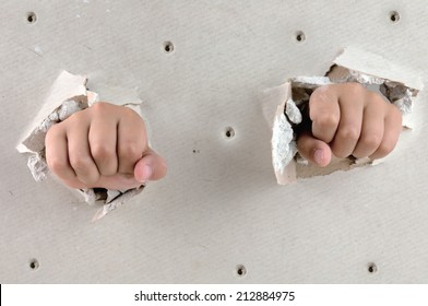 a wall is broken through by a two fist