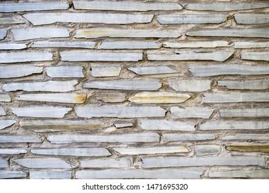 Wall build of grey flagstone