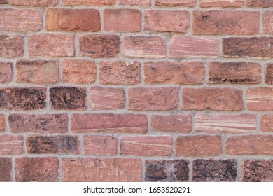 wall build of red sandstone
