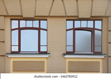 Wall of building with stylish tinted windows