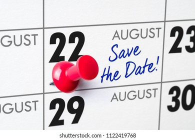 Wall calendar with a red pin - August 22