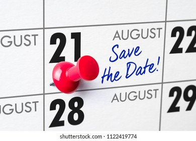 Wall calendar with a red pin - August 21