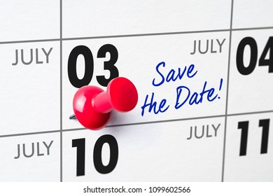 Wall calendar with a red pin - July 03
