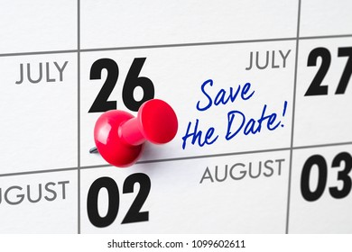 Wall calendar with a red pin - July 26