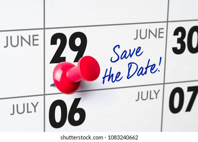 Wall calendar with a red pin - June 29