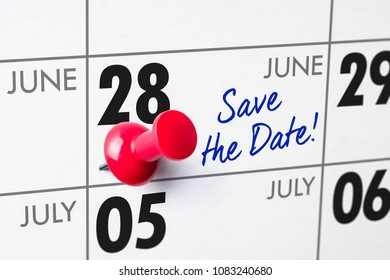 Wall calendar with a red pin - June 28
