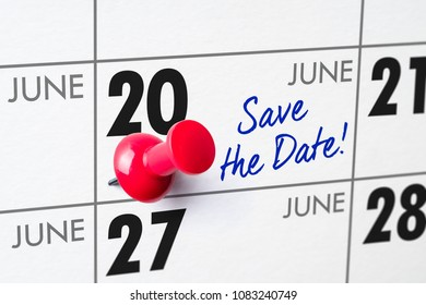 Wall calendar with a red pin - June 20