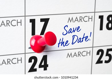 Wall calendar with a red pin - March 17