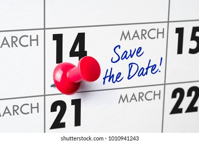 Wall calendar with a red pin - March 14