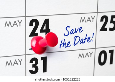 Wall calendar with a red pin - May 24