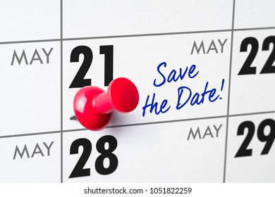 Wall calendar with a red pin - May 21