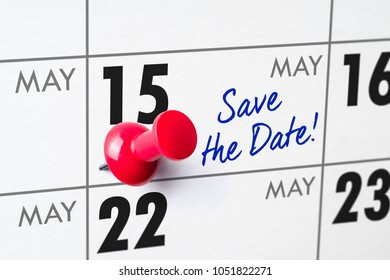 Wall calendar with a red pin - May 15