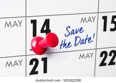 Wall calendar with a red pin - May 14