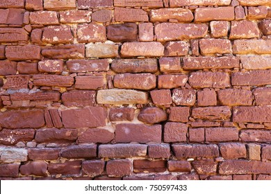 The wall of Castle of Silves from red sandstone. Algarve, Portugal.