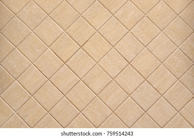 Wall ceramic tile, laid out on the wall in the bathroom.