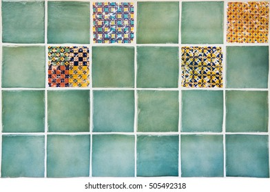 Wall of ceramic tiles in coral shades with geometric pattern. Kitchen decoration. Dimension of square is 10 x 10 cm.