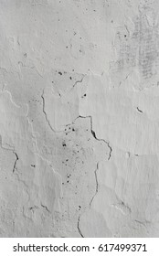 Wall from clay whitewashed with lime, textured background. Ukraine