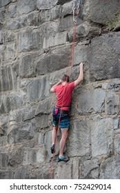 Wall climber at rock wall in St. James Park, Richmond, Virginia