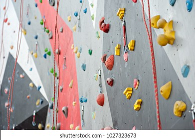 wall climbing wall, with protrusions, ropes and carbines