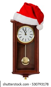Wall clock and cap of Santa Claus, isolated on white background