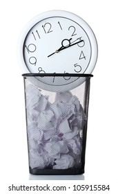 Wall Clock and paper in metal trash bin isolated on white