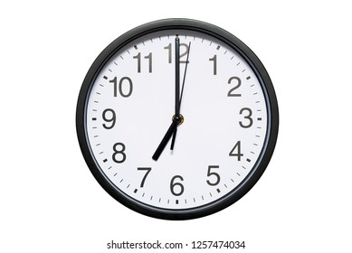 Wall clock shows time 7 o'clock on white isolated background. Round wall clock - front view. Nineteen o'clock