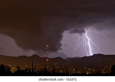 Wall cloud or funnel cloud with lightning during severe thundershower in desert southwest United States