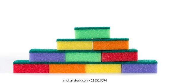 Wall of colored cleaning sponges with abrasive pad