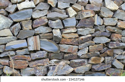 The wall combined from a wild raw stone