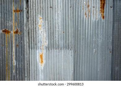 wall of corrugated iron and rusty corrugated iron
