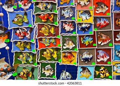 A wall covered with fishy images