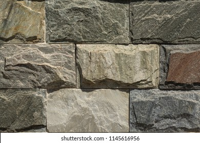 The wall is covered with granite rough slabs