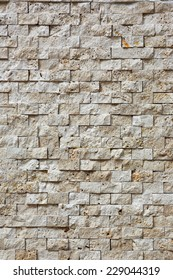 wall is covered with stone tiles