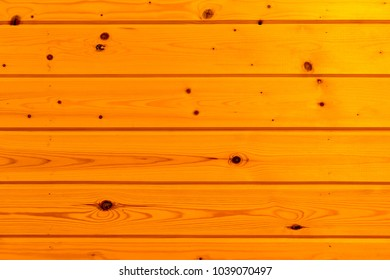 wall is covered with wooden paneling