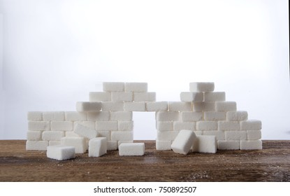 Wall of cubes of white sugar collapsed