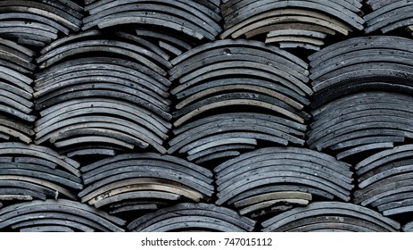 a wall of dark grey Chinese tiles