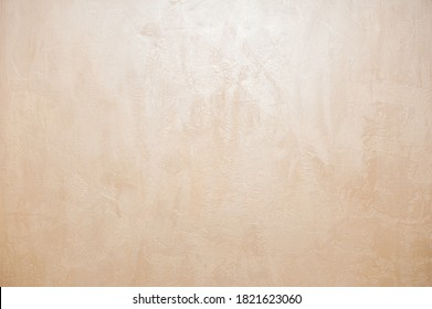 Wall decor Venetian decorative plaster with golden glitter paint. Background, abstraction. Apartment renovation concept. copy space - Shutterstock ID 1821623060