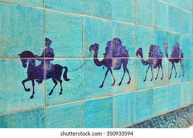Wall decoration in Khiva shows a caravan with camels because Khiva used to be located on the silk road ancient trade route for caravans