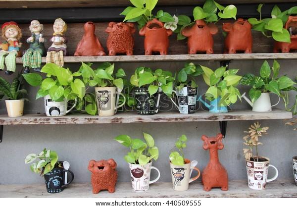 wall design by little plants in mug