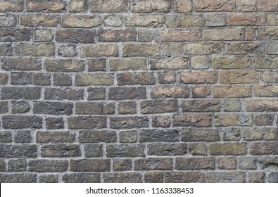 A wall with the detail of the bricks as a background