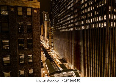 Wall of Downtown Chicago at Night. Golden Color Grading. Train Route and Streets.