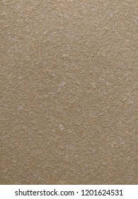 Wall finish resembling the surface of the gypsum board yellowish shades of texture with fine shavings