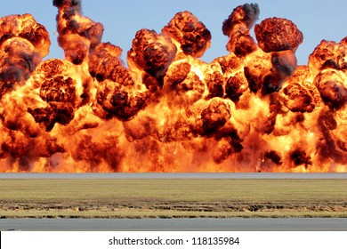A wall of fire, explosion with heat and flame billowing and in motion.